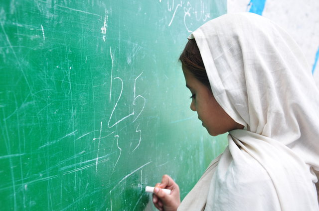 enforce primary and secondary school education in Pakistan